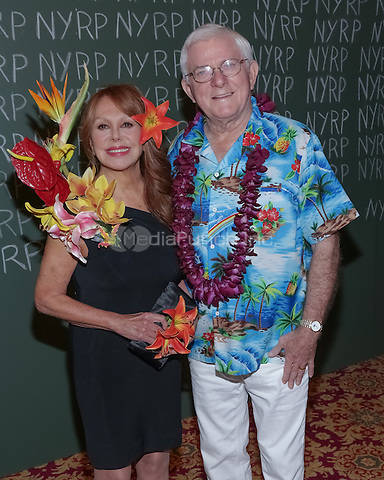 """NEW YORK, NY - OCTOBER 31 :  Actress Marlo Thomas (L) and Phil Donahue arrive for the New York Restoration Project's 19th Annual Hulaween Gala """"FELLINI HULAWEENI"""" held at the Waldorf Astoria on October 31, 2014 in New York City.  (Photo by Brent N. Clarke / MediaPunch)"""