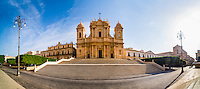 Panoramic photo of St Nicholas Cathedral (Cattedrale di Noto, Duomo) and Basilica San Salvatore in Piazza Municipio, Noto, Sicily, Italy, Europe. This is a panoramic photo of St Nicholas Cathedral (Cattedrale di Noto, Duomo) and Basilica San Salvatore in Piazza Municipio, Noto, Sicily, Italy, Europe.