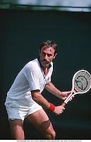 JOHN NEWCOMBE (AUS), Men's Singles, Wimbledon Tennis Championships, 7807. Photo: Leo Mason/Action Plus....1978.man men mens