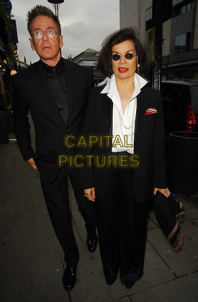 BIANCA JAGGER & GUEST.At the Theatre Museum Fundraising Reception, Theatre Museum, London, England, May 16th 2006..full length round sunglasses white shirt.Ref: CAN.www.capitalpictures.com.sales@capitalpictures.com.©Can Nguyen/Capital Pictures