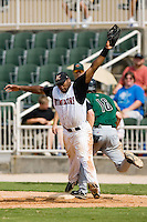 Kannapolis first baseman Brandon Allen (36) stretches for a throw as Augusta right fielder Tyler Graham (16) beats out an infield hit at Fieldcrest Cannon Stadium in Kannapolis, NC, Monday, September 3, 2007.