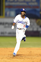 Chattanooga Lookouts second baseman Darnell Sweeney (9) runs the bases on a home run during a game against the Birmingham Barons on April 24, 2014 at AT&T Field in Chattanooga, Tennessee.  Chattanooga defeated Birmingham 5-4.  (Mike Janes/Four Seam Images)