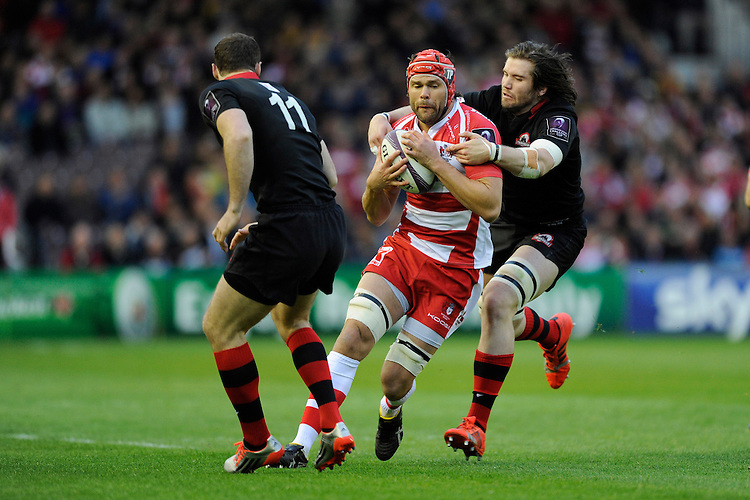 Tom Palmer of Gloucester Rugby is tackled by Ben Toolis of Edinburgh Rugby