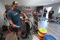 NWA Democrat-Gazette/J.T. WAMPLER  Matt Loyd packs his bag for the Tuesday night mini tournament as players gather in the pro shop, Dynamic Discs of Northwest Arkansas, Tuesday June 5, 2018 at J. Beast Disc Golf Course at J.B. Hunt Park in Springdale.