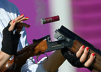 29.07.2012. London, England.  Danka Bartekova of Slovakia  ejects the shell casing  during Womens Skeet Qualification Event AT The London 2012 Olympic Games in London