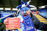 A Leicester City fan with painted face holds a sign warning Madrid, Barcelona and Milan that 'Leicester are coming' before the Barclays Premier League match between Leicester City and Swansea City played at The King Power Stadium, Leicester on 24th April 2016