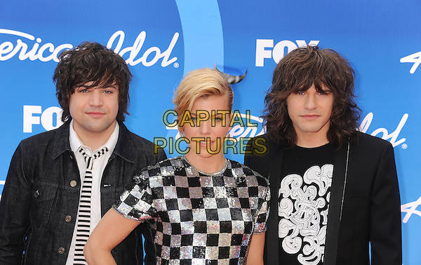 "Neil Perry, Kimberly Perry, Reid Perry of The Band Perry .arriving at FOX's ""American Idol"" Grand Finale at Nokia Theatre L.A. Live in Los Angeles, California, USA,.May 16th 2013..half length band group music hand on hip black silver checked chequered dress suit tie .CAP/ROT/TM.©Tony Michaels/Roth Stock/Capital Pictures"