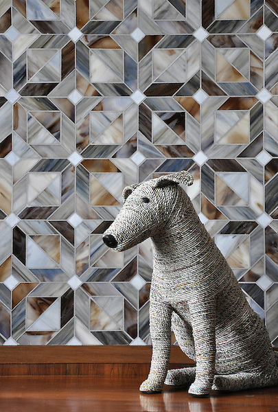 Rubrik, a jewel glass waterjet mosaic shown in Pearl, Schist and Lavastone, is part of the Parquet Line by Sara Baldwin for New Ravenna Mosaics.