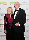 United States Senator Patrick Leahy (Democrat of Vermont), Chairman of the U.S. Senate Judiciiary Committee, and his wife, Marcelle, arrive for the formal Artist's Dinner honoring the recipients of the 2011 Kennedy Center Honors hosted by United States Secretary of State Hillary Rodham Clinton at the U.S. Department of State in Washington, D.C. on Saturday, December 3, 2011. The 2011 honorees are actress Meryl Streep, singer Neil Diamond, actress Barbara Cook, musician Yo-Yo Ma, and musician Sonny Rollins..Credit: Ron Sachs / CNP