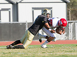 Palos Verdes, CA 10/27/17 - Wyatt Chang (Peninsula #9) and Tyree Brown (Morningside #7)in action during the Morningside Monarchs - Palos Verdes Peninsula Varsity football game at Peninsula High School.
