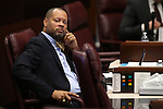 Nevada Senate Minority Leader Aaron Ford, D-Las Vegas, works on the Senate floor at the Legislative Building in Carson City, Nev., on Friday, Dec. 18, 2015. Lawmakers are working in a special Legislative session to consider an economic development deal between the state and Faraday Future. <br /> Photo by Cathleen Allison