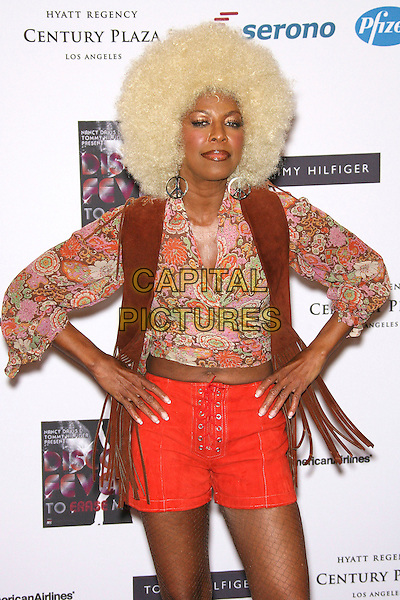 NATALIE COLE<br /> 13th Annual Race to Erase MS - Arrivals held at the Hyatt Regency Century Plaza Hotel, Century City, California, USA, 12 May 2006.<br /> half length blonde afro wig seventies costume hands on hips<br /> Ref: ADM/ZL<br /> www.capitalpictures.com<br /> sales@capitalpictures.com<br /> &copy;Zach Lipp/AdMedia/Capital Pictures