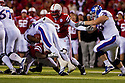 13 November 2010: Nebraska Cornhuskers cornerback Marcus Mendoza #32 jumped on top the his teammates before the Kansas game to throw the bones for the Husker fans at Memorial Stadium in Lincoln, Nebraska. Nebraska defeated Kansas 20 to 3.