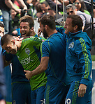 Seattle Sounders teammates surround Clint Dempsey after he scored his second goal against the Colorado Rapids during an MLS match on April 26, 2014 in Seattle, Washington.  The Seattle Sounders beat the Colorado Rapids 4-1.  Jim Bryant Photo. ©2014. All Rights Reserved.