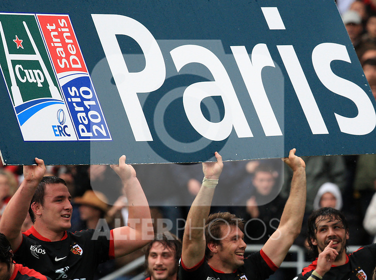 Louis Picamoles and Vincent Clerc hold up a advertising board after winning the Heineken Cup semi final match between Stade Toulousain and Leinster at Stade Municipal on May 1, 2010 in Toulouse, France.
