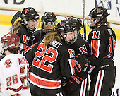 The Huskies celebrate Katie MacSorley's (NU - 3) goal. - The Boston College Eagles defeated the visiting Northeastern University Huskies 2-1 on Sunday, January 30, 2011, at Conte Forum in Chestnut Hill, Massachusetts.