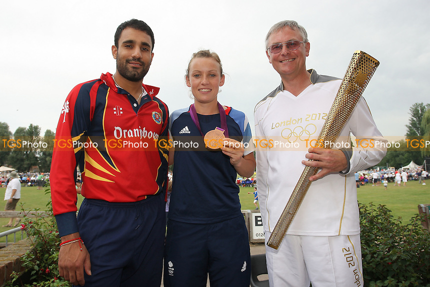 Team GB Olympic Hockey Medalist Chloe Rogers poses for a photograph with Essex cricketer Ravi Bopara (L) and torch bearer Ken Edwards - Essex Eagles vs Netherlands - Clydesdale Bank 40 Cricket at Castle Park, Colchester - 19/08/12 - MANDATORY CREDIT: Gavin Ellis/TGSPHOTO - Self billing applies where appropriate - 0845 094 6026 - contact@tgsphoto.co.uk - NO UNPAID USE.