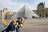 Tourists in front of The Lourve Pyramid