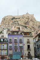 Spain, Alicante, a beach town and historic Mediterranean port. Buildings in front of Santa Barbara Castle.
