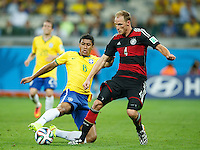 Paulinho of Brazil and Benedikt Howedes of Germany