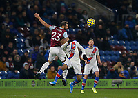 30th November 2019; Turf Moor, Burnley, Lanchashire, England; English Premier League Football, Burnley versus Crystal Palace; Erik Pieters of Burnley wins a header against Jordan Ayew of Crystal Palace - Strictly Editorial Use Only. No use with unauthorized audio, video, data, fixture lists, club/league logos or 'live' services. Online in-match use limited to 120 images, no video emulation. No use in betting, games or single club/league/player publications