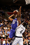 Kentucky forward Sheray Thomas (23) shoots over Connecticut forward Jeff Adrien (4).  Connecticut defeated Kentucky 87-83 in the second round of the NCAA Tournament  at the Wachovia Center in Philadelphia, Pennsylvania on March 19, 2006.