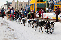 Musher Jessica Hendricks and Iditarider Pam Metcalf.leave the 2011 Iditarod ceremonial start line in downtown Anchorage, Alaska