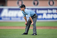 Umpire Roberto Pattison handles the calls on the bases during the New York Penn League game between the Hudson Valley Renegades and the Aberdeen IronBirds at Leidos Field at Ripken Stadium on July 27, 2017 in Aberdeen, Maryland.  The Renegades defeated the IronBirds 2-0 in game one of a double-header.  (Brian Westerholt/Four Seam Images)