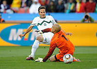 Zlatan Ljubijankic (0) of Slovenia scores the second goal past USA goalkeeper Tim Howard (1), 2-0. USA vs Slovenia in the 2010 FIFA World Cup at Ellis Park in Johannesburg, South Africa on June 18th, 2010.