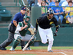SIOUX FALLS, SD - MAY 20:  Brandon Jones #22 from the Sioux Falls Canaries runs to first base on a base hit against the Gary Southshore Railcats in the first inning Tuesday evening at the Canaries Stadium.  (Photo by Dave Eggen/Inertia)