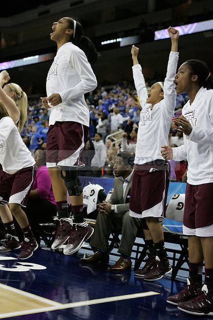 The TAMU bench celebrates during the second half of the University of Kentucky women's basketball game vs. Texas A&M University during the SEC Tournament Championship Game at The Arena at Gwinnett Center in Duluth, Ga. on Sunday, March 10, 2013. Texas A&M won 75-67. Photo by Genevieve Adams | Staff