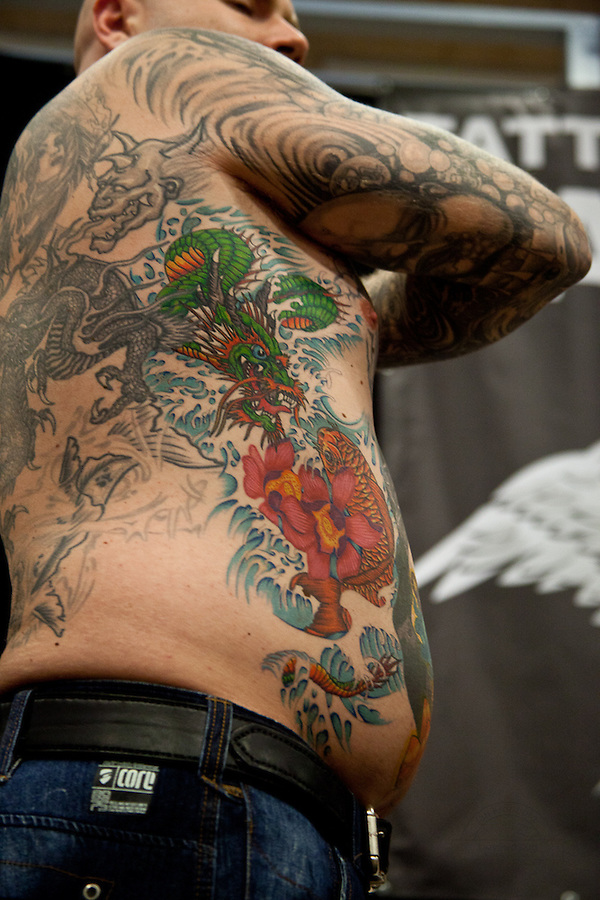 Tattoo Convention in Kolding 2011. Arranged by BodyMod.dk<br /> Japanese dragon and flower on ribs.