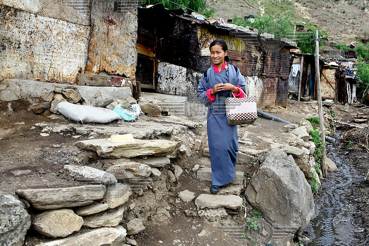 A young woman walks down steps in the kala bazaar slum.