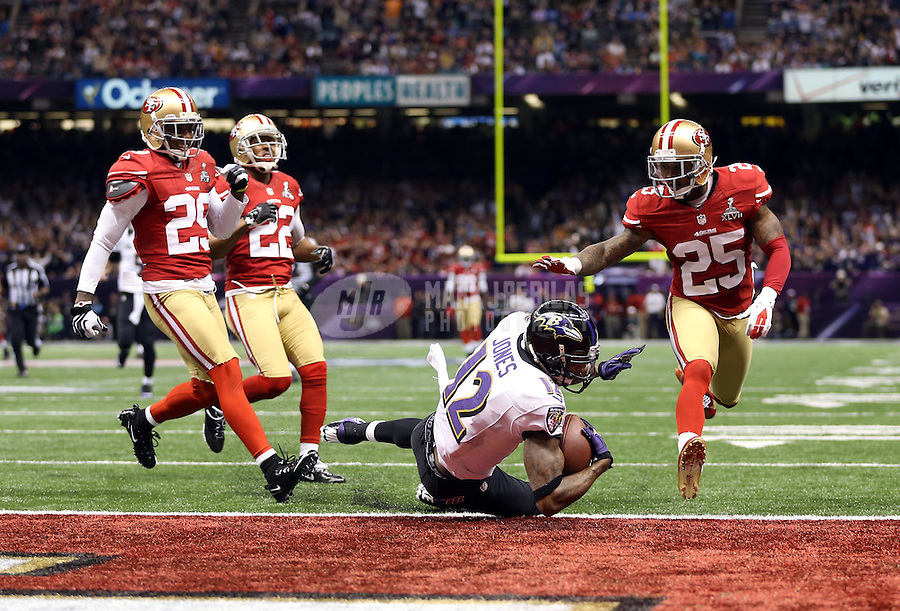 Feb 3, 2013; New Orleans, LA, USA; Baltimore Ravens wide receiver Jacoby Jones (12) dives into the end zone and scores a touchdown against the San Francisco 49ers in the second quarter in Super Bowl XLVII at the Mercedes-Benz Superdome. Mandatory Credit: Mark J. Rebilas-