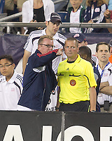 New England Revolution head coach Steve Nicol discusses finer points of soccer with fourth official. In a Major League Soccer (MLS) match, the Los Angeles Galaxy defeated the New England Revolution, 1-0, at Gillette Stadium on May 28, 2011.