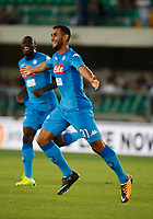 Faouzi Ghoulam celebrates after scoring during the  italian serie A soccer match,between Hellas Verona and SSC Napoli  at  the Bentegodi    stadium in Verona  Italy , August 19, 2017