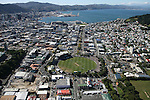 Looking through the Basin reserve to Wellington Harbour. Wellington scenes. Photo: Marc Weakley