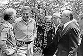 United States President Jimmy Carter, left, chats with Prime Minister Menachem Begin, right, and his party after their meeting at Camp David, near Thurmont, Maryland prior to their meeting on Friday, September 16, 1978.  From left to right: President Carter; Defense Minister Ezer Weizman of Israel, Aliza Begin, wife of the Prime Minister; Yehiel Kadishai, Director of the Office of the Prime Minister; and Prime Minister Begin..Credit: White House via CNP
