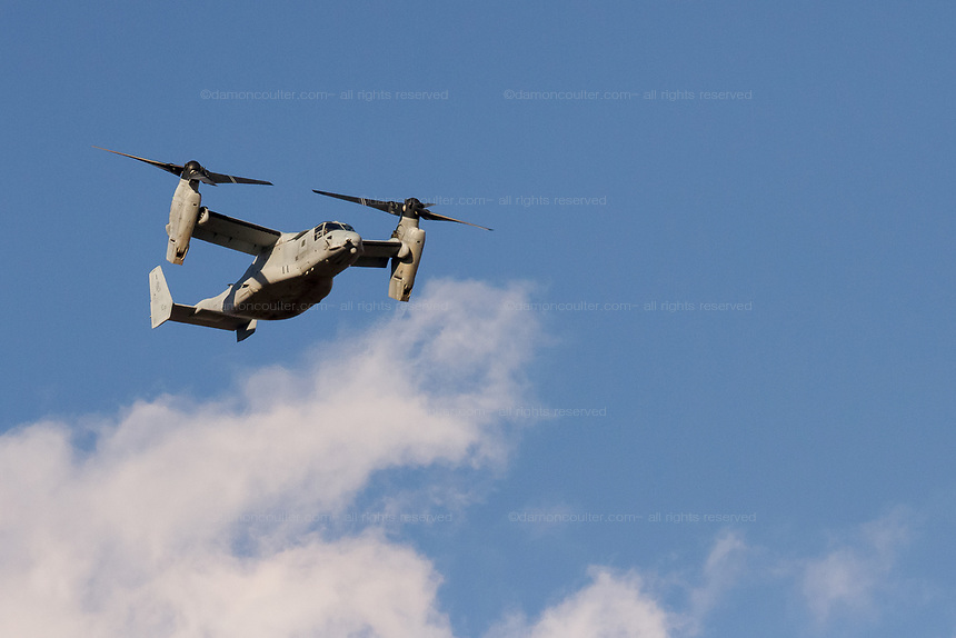 Bell Boeing V-22 Osprey tilt-rotor aircraft, operated by the US Marine Corps, flying over Chuo Rinkan in Kanagawa, Japan. Tuesday February 13th 2018. The Osprey has a patchy safety record and there have several accidents in Japan.. Many people would like to see the aircraft banned from flying over Japan. The majority of Ospreys operate from bases on Okinawa and seeing them fly in the Tokyo Kanagawa area is very rare and certain to raise fear of crashes.