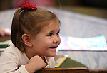 Amelia Papez, 3, watches the arrival of Santa during Storytime at the Carson City Library on Thursday, Dec. 13, 2012. .Photo by Cathleen Allison