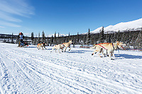 Jimmy Lanier and team run down the trail on the Denali Highway with the Alaska Range in the background during the start day of the 2015 Junior Iditarod on Sunday March 1, 2015<br /> <br /> <br /> (C) Jeff Schultz/SchultzPhoto.com - ALL RIGHTS RESERVED<br />  DUPLICATION  PROHIBITED  WITHOUT  PERMISSION
