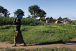 World Water Day. A woman are transporting water from the well of a village on the way to Kerteibe Tambakunda