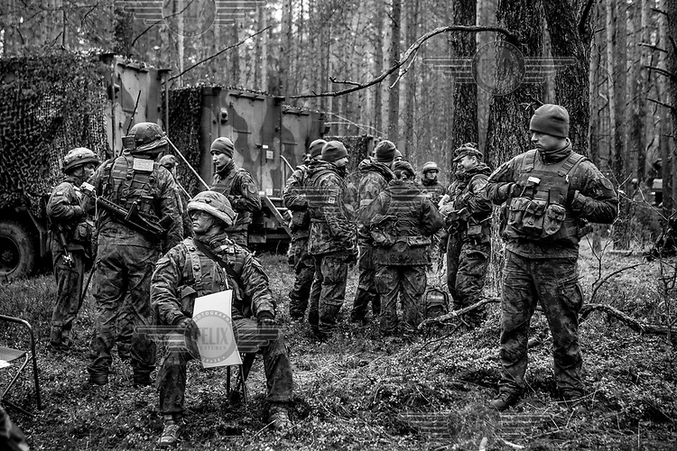 Lithuanian troops preparing an assault on the enemy during NATO Iron Sword joint exercises.