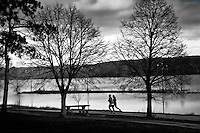Couple runs along the bike and running path that parallels Hoover Reservoir near Westerville, Ohio, on a cloudy, cool afternoon.