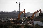 Israeli bulldozers demolish a dairy factory, at the al-Rama neighborhood near the West Bank city of Hebron on September 2, 2014. Israeli bulldozers demolished a dairy factory in Hebron and Bedouin homes east of Jerusalem early Tuesday. Photo by Mamoun Wazwaz
