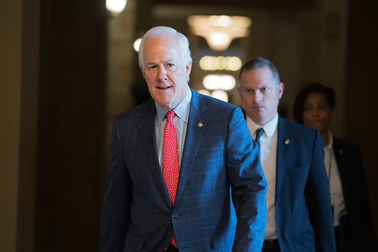 UNITED STATES - FEBRUARY 08: Senate Majority Whip John Cornyn, R-Texas, makes his way to a Senate Republican luncheon in the Capitol. (Photo By Tom Williams/CQ Roll Call)