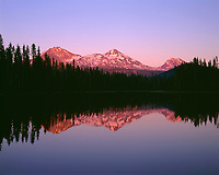 ORCAC_108 - USA, Oregon, Willamette National Forest, Sunset reddens the Three Sisters (left to right: North, Middle and South Sister) which reflect in Scott Lake.
