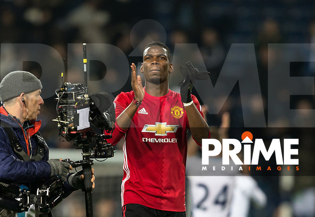 Paul Pogba of Manchester United applauds the support during the EPL - Premier League match between West Bromwich Albion and Manchester United at The Hawthorns, West Bromwich, England on 17 December 2016. Photo by Andy Rowland / PRiME Media Images.