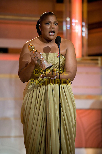 "MO'NIQUE (Monique Imes).Accepts the Golden Globe Award for BEST PERFORMANCE BY AN ACTRESS IN A SUPPORTING ROLE IN A MOTION PICTURE for her role in ""Precious: Based On The Novel Push By Sapphire"" at the 67th Annual Golden Globe Awards at the Beverly Hilton in Beverly Hills, CA, USA..January 17th, 2010.                               .globes stage microphone half length dress strapless khaki gold green olive gown award trophy winner mouth open.CAP/AW/HFPA.Supplied by Anita Weber/Capital Pictures"