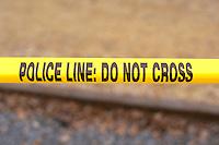 Yellow police line tape: DO NOT CROSS at Cinco de Mayo Festival.  St Paul Minnesota USA